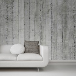 Greyscale image of an upholstered white sofa against a concrete